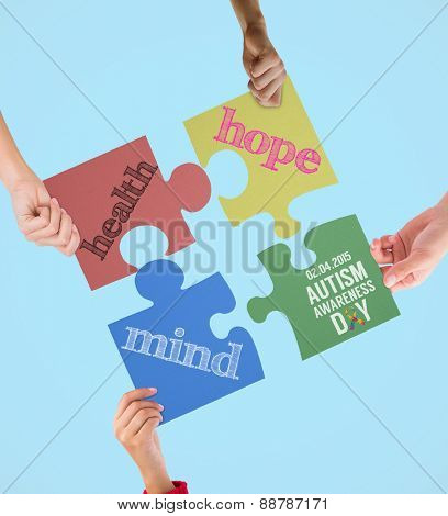 Autism awareness day against blue background with vignette