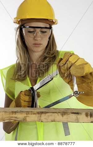 Girl Using A Saw