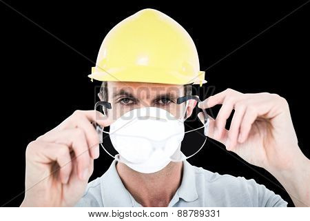 Worker wearing protective glasses over white background against black