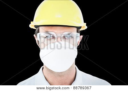 Worker wearing protective mask and glasses against black