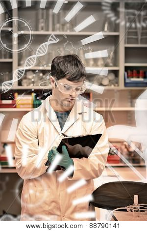 Science and medical graphic against concentrated male scientist writing on a clipboard