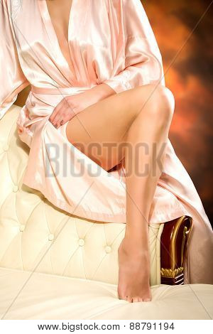 Beauty woman slim legs at colored  background