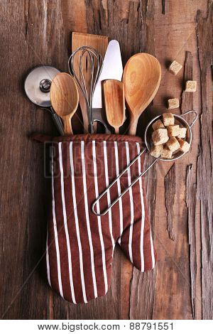 Set of kitchen utensils on rustic wooden table background