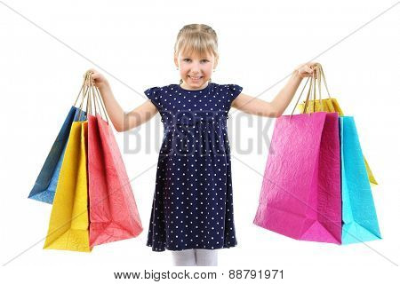 Beautiful little girl with shopping bags isolated on white