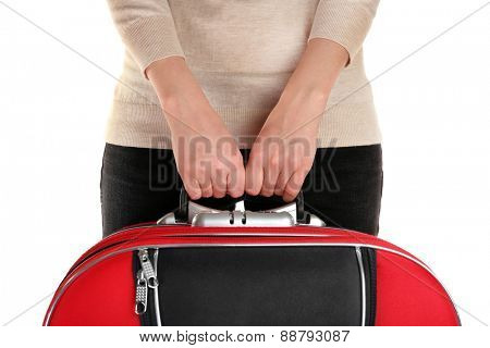 Woman holding suitcase isolated on white