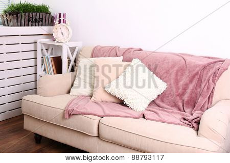 Modern room with comfortable sofa, indoors