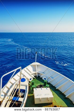 Snout of the sailing ship in the open blue sea in sunny day.