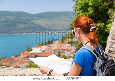 Traveling girl with map