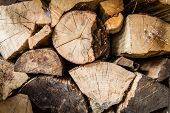 foto of firewood  - A pile of irregularly stacked pieces of firewood - JPG