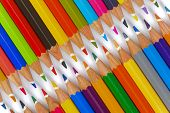 picture of zipper  - group of colorful pencils shows zipper as symbol for teamwork - JPG
