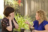 stock photo of comrades  - Women and friendship sharing stories over a cup of coffee outdoors - JPG