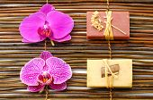 stock photo of washtub  - Set of nature soap with orchid on bamboo mat - JPG