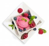 pic of dessert plate  - Top view of ice cream dessert with blueberries on a white plate isolated on white - JPG