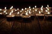 picture of sad christmas  - Group of burning candles on  black background - JPG