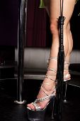 picture of flogger  - leather flogger and leg of strip dancer in night club - JPG
