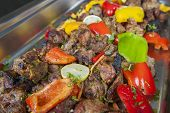 picture of buffet  - Closeup detail of beef tandoori kebab pieces on display at an indian restaurant buffet - JPG