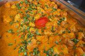 foto of punjabi  - Closeup detail of a dum aloo punjabi potato curry dish on display at an indian restaurant - JPG