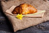 foto of croissant  - Fresh croissant on old wooden table - JPG