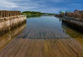 pic of lobster boat  - A boat slip at a commercial lobster fishing wharf in rural Prince Edward Island - JPG