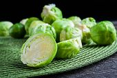 picture of brussels sprouts  - brussels sprouts on old wood table - JPG