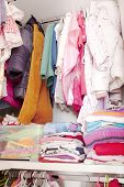 image of wardrobe  - A wardrobe full of colored child clothes - JPG