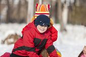 picture of snowball-fight  - Children in winter park having fun and playing snowballs - JPG