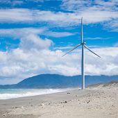 pic of generator  - Wind turbine power generators silhouettes at ocean coastline - JPG