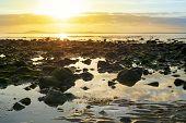 foto of ireland  - reflections at rocky beal beach near ballybunion on the wild atlantic way ireland with a beautiful yellow sunset - JPG