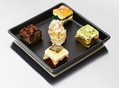 stock photo of petition  - Assortment of petit four pastries Sweet food and desserts - JPG