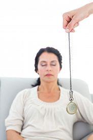foto of hypnotic  - Woman being hypnotized on white background - JPG