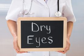 picture of slating  - Female Doctor Holding Slate Chalkboard With The Text Dry Eyes - JPG