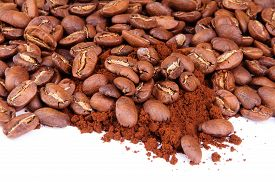 foto of coffee grounds  - Closeup coffee beans at roasted coffee heap - JPG