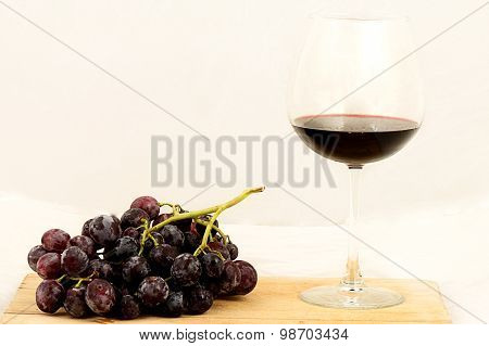 Bunch of Grapes and  one wine glass