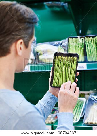 Man Buys A Asparagus In Store