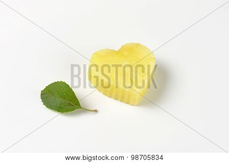apple pulp heart and leaf on white background