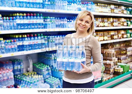 Woman With Packing Drinking Water