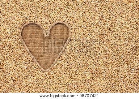 The Symbolic Heart Made Of Rope Lies On Sackcloth And Pearl Barley Grains