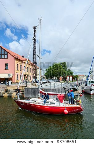 Yacht Passes Through Moat Of Dassel In Castle Port Of Klaipeda