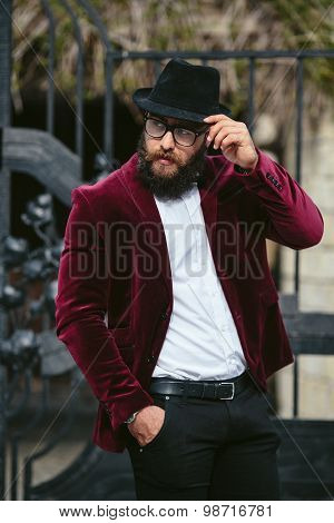 rich man with a beard, thinking about business