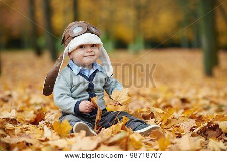 little boy in helmet pilot