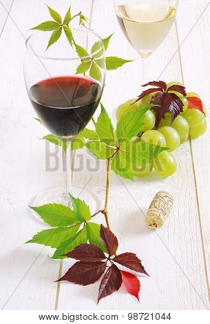 Glasses Of Red Wine, White Wine And Bunch Of Green Grapes