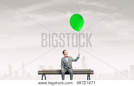 Businessman with balloon