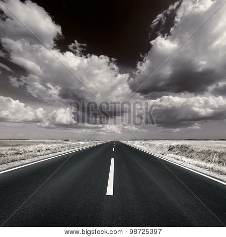 Driving On Asphalt Road In Black And White