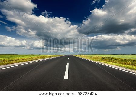 Driving On Straight Asphalt Road At Idyllic Sunny Day