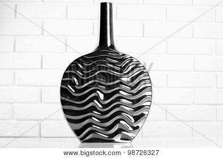 Modern vase on floor in room