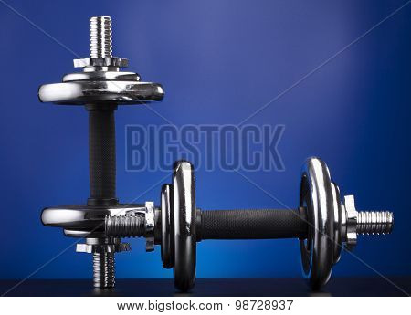 dumbbells on blue