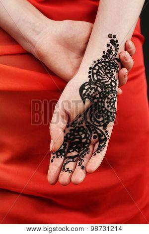 Image of henna on female hand, closeup