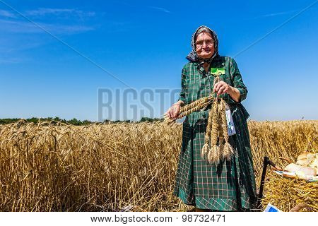 Granny Holding Adornment Made Of Wheat.
