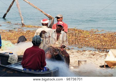 Fishermen On Boat With Net