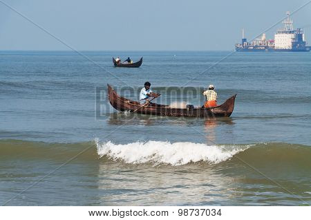 Fishermen In A Boat Catch Fish